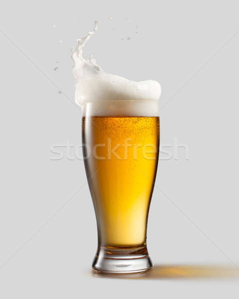 Frosty glass of light beer with foam Stock photo © artjazz