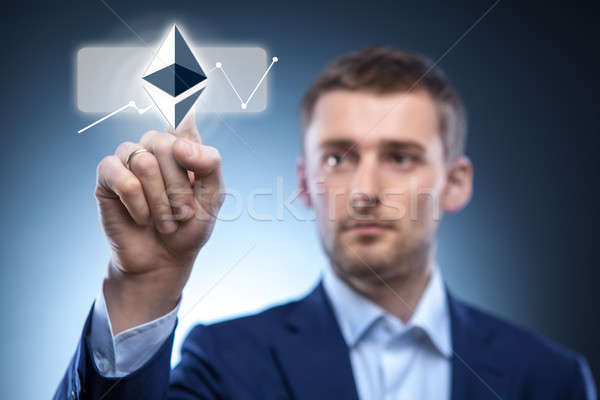 hand man touch the ripple icon on the web screen Stock photo © artjazz