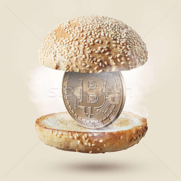 Burger with gold coin bitcoin on beige background Stock photo © artjazz
