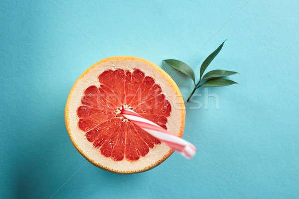 Half grapefruit stro groene bladeren Blauw top Stockfoto © artjazz