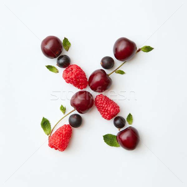 Organic berry pattern of letter X english alphabet from natural ripe berries - black currant, cherri Stock photo © artjazz