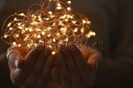 Brilhante luzes mãos mulher tatuagem Foto stock © artjazz