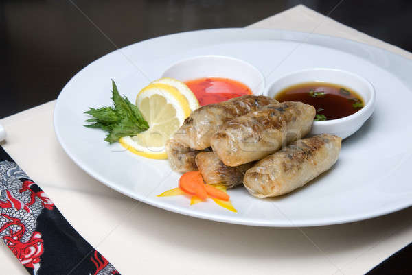 chinese rolls with meat on the plate Stock photo © artjazz