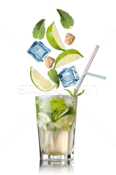 mohito cocktail with falling ingredients isolated on white Stock photo © artjazz