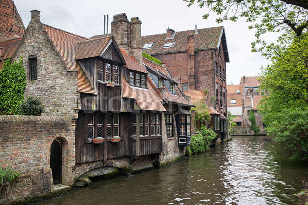 Houses along the canals of Brugge or Bruges Stock photo © artjazz