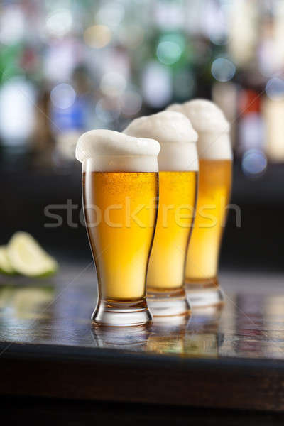Hideg világos sör bögre kocsma három szemüveg Stock fotó © artjazz
