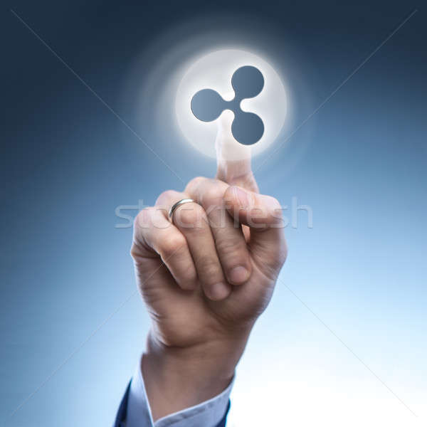 the hand of a man touches a ripple icon Stock photo © artjazz