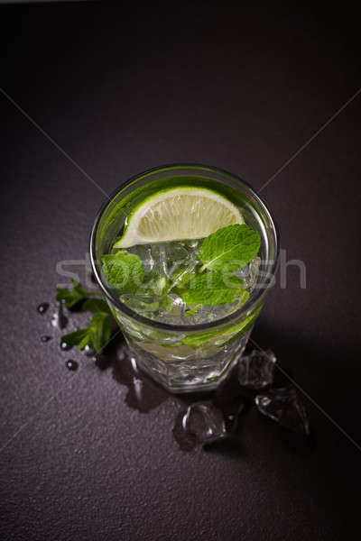 refreshing summer lemonade mojito in a glass on a black background. Stock photo © artjazz