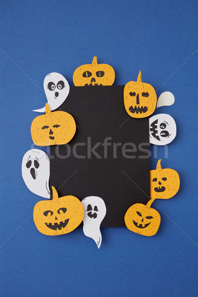 Square creative frame of black paper with handmade laughing flying ghosts, spirits, scary pumpkin on Stock photo © artjazz