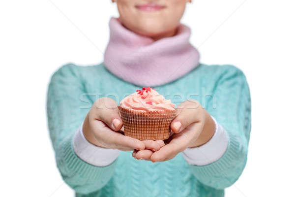 Woman holding a pink cupcake on white Stock photo © artjazz