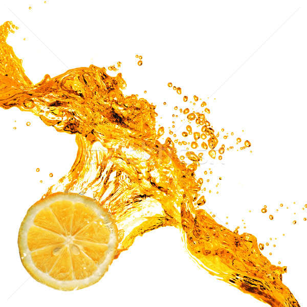 Orange slice splash sap geïsoleerd witte wijn Stockfoto © artjazz