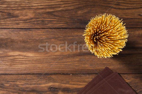 italian spaghetti and napkin on wooden background Stock photo © artjazz