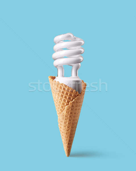 Compact fluorescent bulb in ice cream cone Stock photo © artjazz