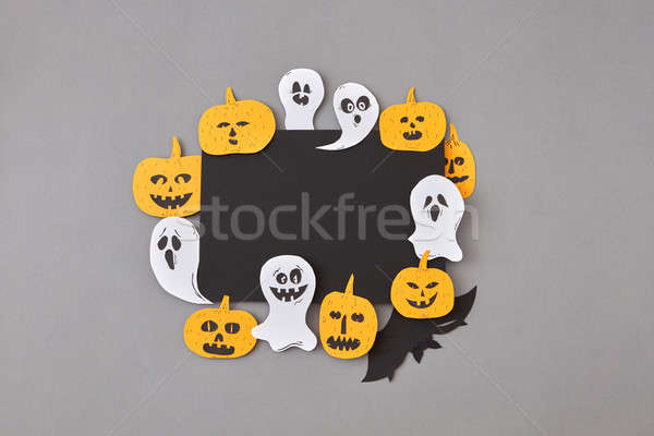 Halloween party handmade card of laughing flying ghosts, spirits, scary pumpkin and bats around it o Stock photo © artjazz