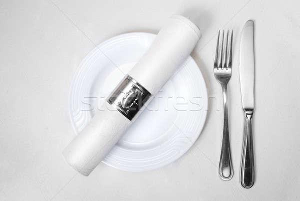 Couteau fourche plaque serviette restaurant fond Photo stock © artjazz