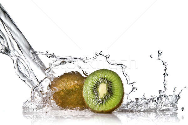 Water splash on kiwi isolated on white Stock photo © artjazz