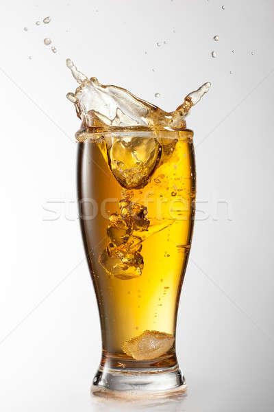 Ijs vallen bier glas splash geïsoleerd Stockfoto © artjazz