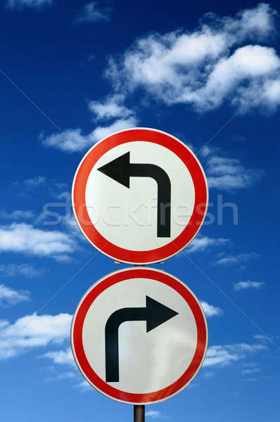 two opposite road signs against blue sky and clouds Stock photo © artjazz
