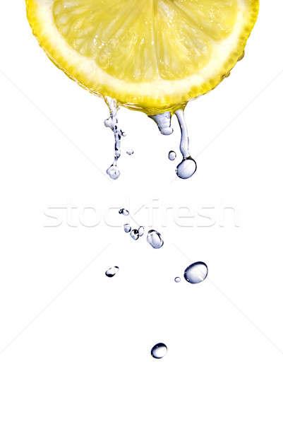 Zoetwater druppels citroen geïsoleerd witte voedsel Stockfoto © artjazz