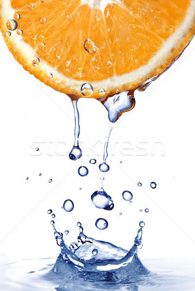 fresh water drops on orange with water splash  isolated on white Stock photo © artjazz