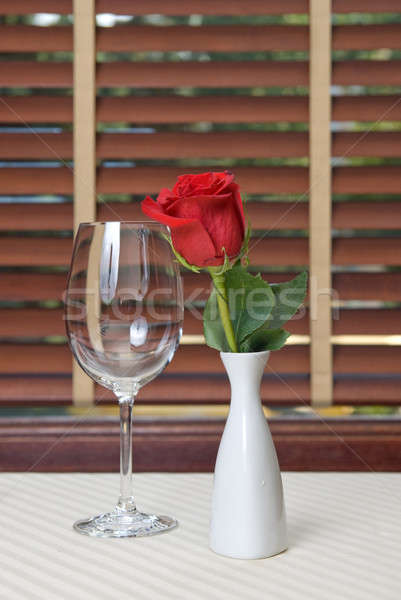 wineglass and rose on the table Stock photo © artjazz