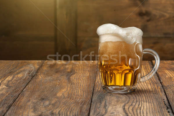 Light beer in mug on wood Stock photo © artjazz