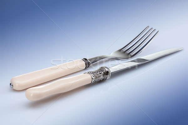 knife and fork on blue Stock photo © artjazz