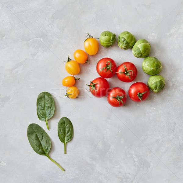 Tomaten spinazie bladeren Rood Geel groene Stockfoto © artjazz