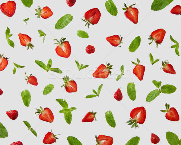 Strawberry and mint leaves isolated on gray background. Creative food concept Stock photo © artjazz