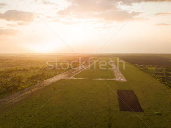Aerial view from the drone, a bird's eye view of abstract geometric forms of abandoned runway, fores Stock photo © artjazz