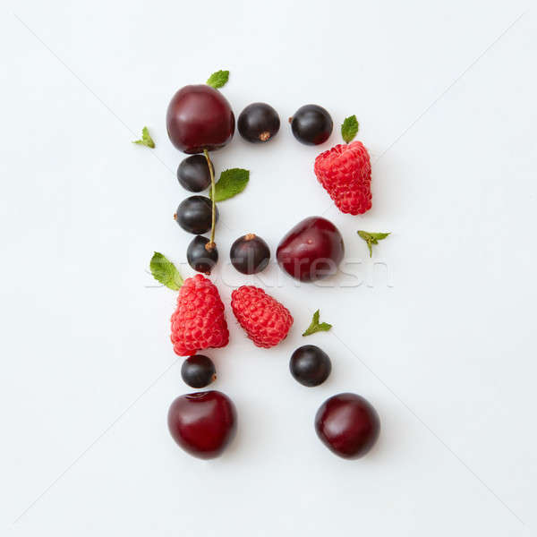 Summer pattern of letter R english alphabet from natural ripe berries - black currant, cherries, ras Stock photo © artjazz