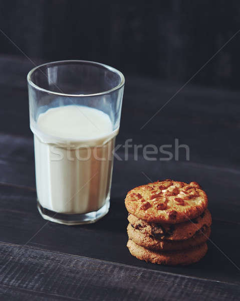 Homemade oatmeal biscuits with peanut and glass of milk on a textile background - traditional Christ Stock photo © artjazz