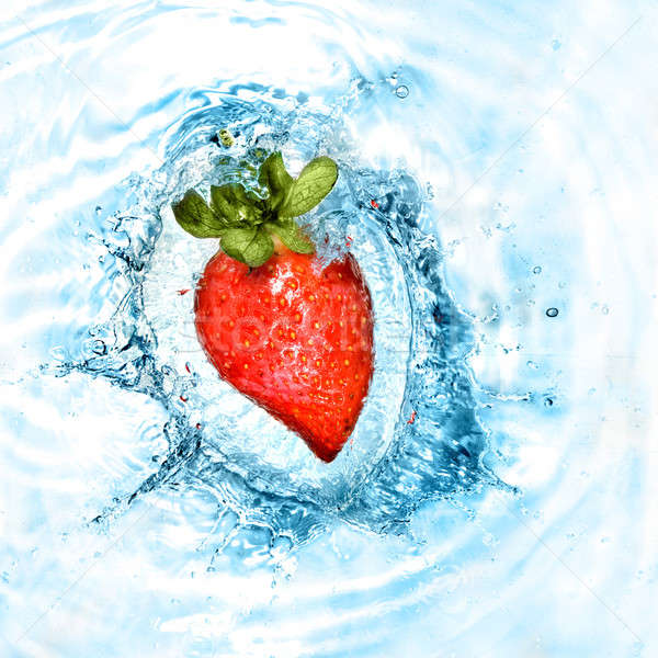 heart from strawberry dropped into water with splash isolated on white Stock photo © artjazz