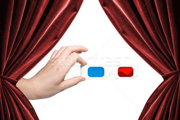 hand holding stereo glasses on white background with curtains Stock photo © artjazz