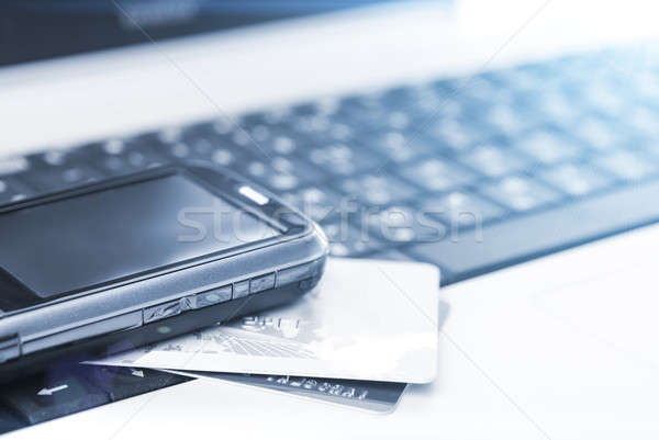 Kredi kartları cep telefonu dizüstü bilgisayar defter iş bilgisayar Stok fotoğraf © artjazz