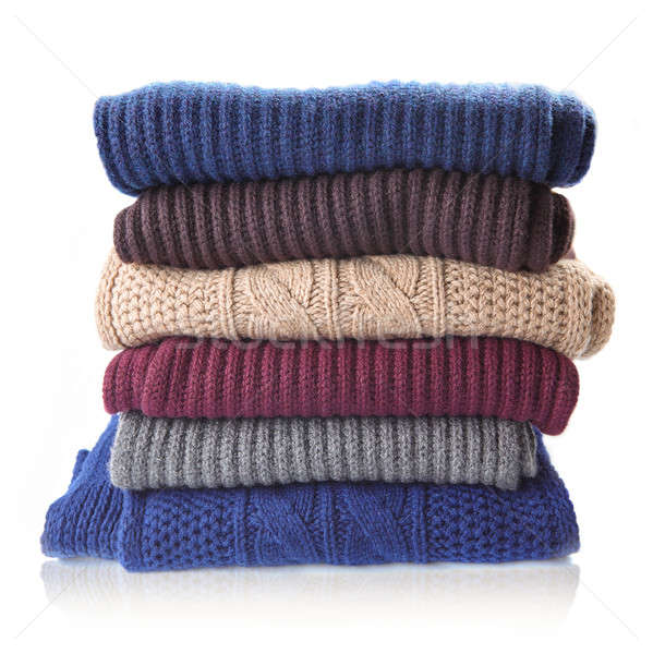 Pile of knitted winter clothes Stock photo © artjazz