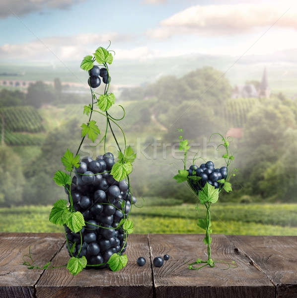 Vetro bottiglia di vino tavolo in legno bottiglia vino vite Foto d'archivio © artjazz