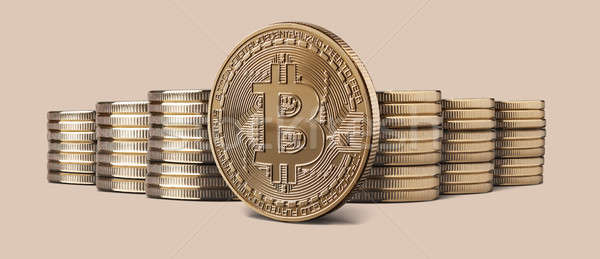 Cryptocurrency physical bitcoin gold coin and stacks of coins on backgound Stock photo © artjazz