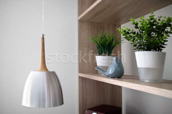 Chandeliers and flowers in pots on wooden shelves Stock photo © artjazz