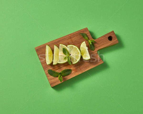 Natural ingredients for preparation natural homemade alcoholic mojito. Slices of natural organic gre Stock photo © artjazz