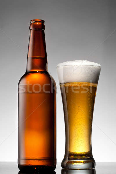 Beer in glass and bottle on white Stock photo © artjazz