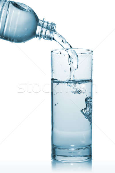 water pouring into glass from bottle isolated on white Stock photo © artjazz