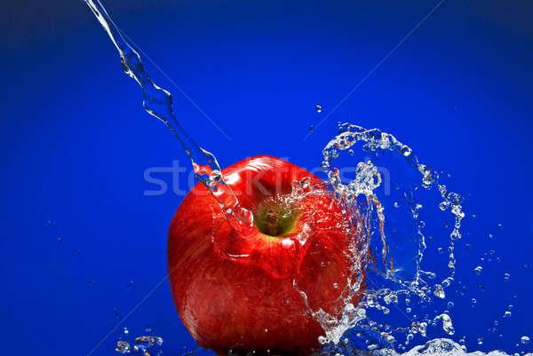 Zielone jabłko niebieski zdrowia tle Zdjęcia stock © artjazz