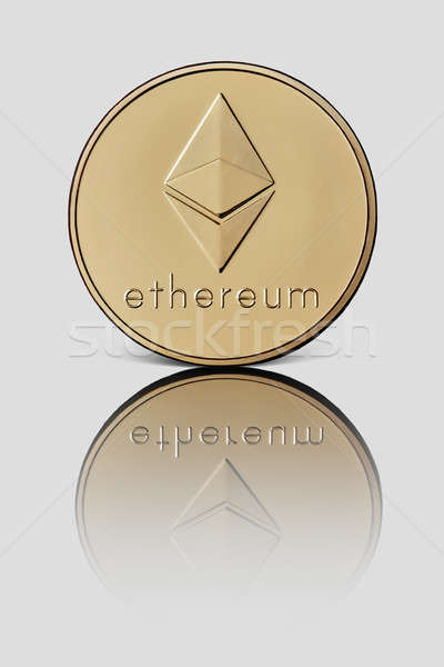 Gold coin ethereum represented on a white glossy background Stock photo © artjazz