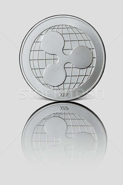 Silver coin ripple on white glossy background. Stock photo © artjazz