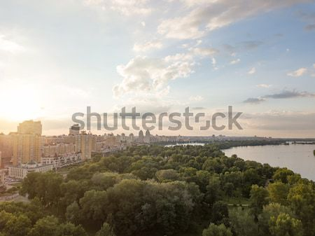 Panoramic aerial view from the drone to Obolon district, park Natalka, river Dnieper in Kiev. Stock photo © artjazz