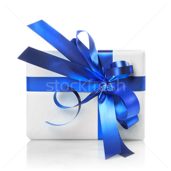 Stock photo: Holiday gift with blue ribbon isolated on white