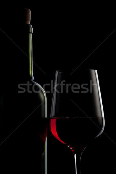 red wine in glass and bottle isolated on black Stock photo © artjazz