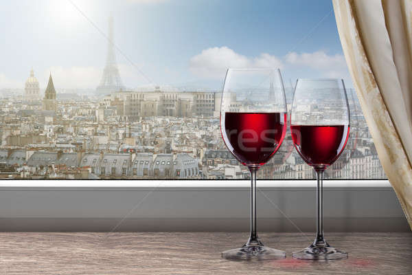 View of Paris and Eiffel tower from window with two glasses of w Stock photo © artjazz