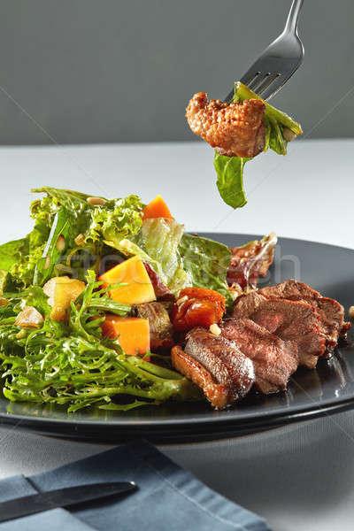 Lezzetli ızgara ördek kabak salata Stok fotoğraf © artjazz
